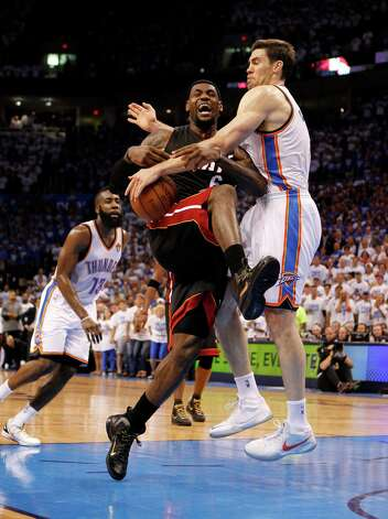 The Miami Heat's LeBron James is fouled by the Oklahoma City Thunder's Nick Collison, right, in the fourth quarter in Game 2 of the NBA Finals on Thursday, June 14, 2012, at Chesapeake Energy Arena in Oklahoma City, Oklahoma. The Heat won, 100-96,to even the series, 1-1. (Charles Trainor Jr./Miami Herald/MCT) Photo: Charles Trainor Jr., McClatchy-Tribune News Service / Miami Herald