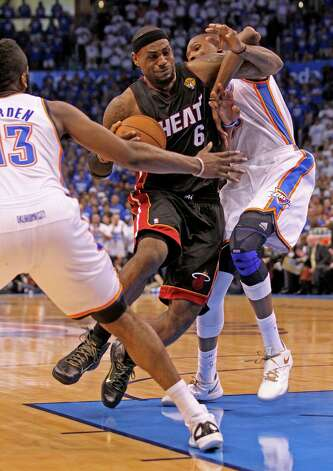 The Oklahoma City Thunder's Kevin Durant, right, fouls the Miami Heat's LeBron James in the third quarter in Game 2 of the NBA Finals on Thursday, June 14, 2012, at Chesapeake Energy Arena in Oklahoma City, Oklahoma. The Heat won, 100-96,to even the series, 1-1. (Al Diaz/Miami Herald/MCT) Photo: Al Diaz, McClatchy-Tribune News Service / Miami Herald