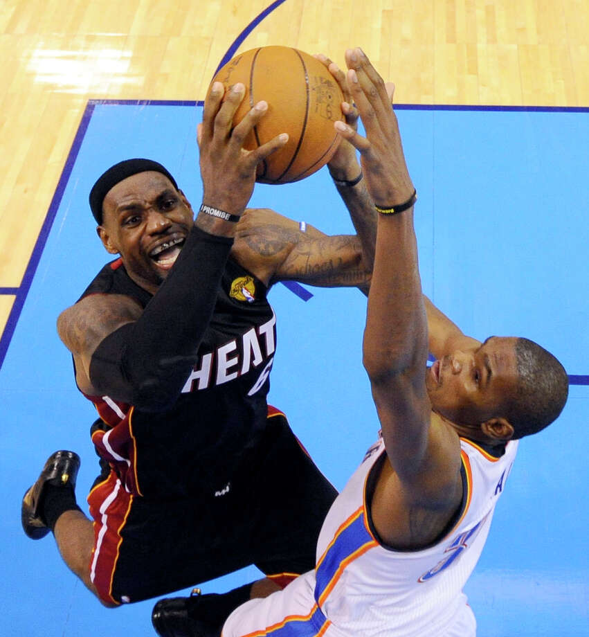 Miami Heat small forward LeBron James  is defended by Oklahoma City Thunder small forward Kevin Durant (35) during the second half at Game 2 of the NBA finals basketball series, Thursday, June 14, 2012, in Oklahoma City. The Heat won 100-96. (AP Photo/Larry W. Smith, Pool) Photo: Larry W. Smith, Associated Press / EPA Pool