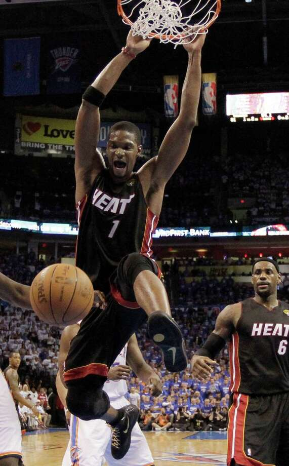 Miami Heat power forward Chris Bosh  dunks against the Oklahoma City Thunder on during the second half at Game 2 of the NBA finals basketball series, Thursday, June 14, 2012, in Oklahoma City. The Heat won 100-96. (AP Photo/Jeff Roberson) Photo: Jeff Roberson, Associated Press / AP