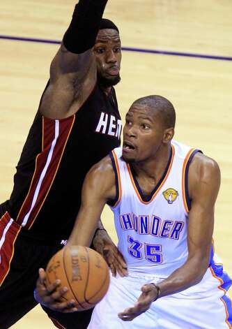 Oklahoma City Thunder small forward Kevin Durant (35) shoots around Miami Heat small forward LeBron James during the second half at Game 2 of the NBA finals basketball series, Thursday, June 14, 2012, in Oklahoma City. (AP Photo/Sue Ogrocki) Photo: Sue Ogrocki, Associated Press / AP
