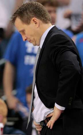 Oklahoma City Thunder head coach Scott Brooks reacts against the Miami Heat during the second half at Game 2 of the NBA finals basketball series, Thursday, June 14, 2012, in Oklahoma City. (AP Photo/Jeff Roberson) Photo: Jeff Roberson, Associated Press / AP