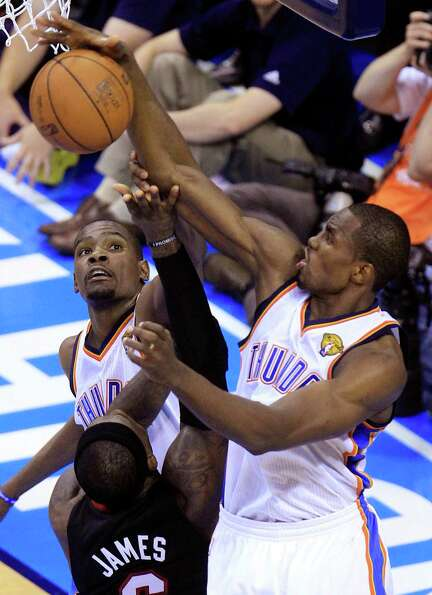 Miami Heat small forward LeBron James  is blocked by Oklahoma City Thunder power forward Serge Ibaka