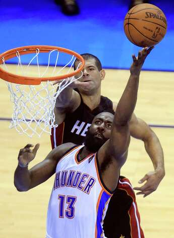 Oklahoma City Thunder guard James Harden (13) shoots as Miami Heat small forward Shane Battier  defends during the second half at Game 2 of the NBA finals basketball series, Thursday, June 14, 2012, in Oklahoma City. (AP Photo/Sue Ogrocki) Photo: Sue Ogrocki, Associated Press / AP