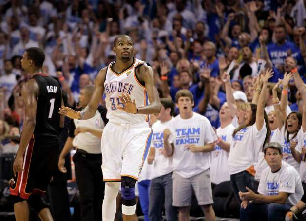 Oklahoma City Thunder small forward Kevin Durant (35) reacts after hitting a three-point shot in the last minute at Game 2 of the NBA finals basketball series, Thursday, June 14, 2012, in Oklahoma City. The Miami Heat heat won 100-96. (AP Photo/Jeff Roberson) Photo: Jeff Roberson, Associated Press / AP