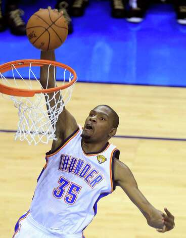 Oklahoma City Thunder small forward Kevin Durant (35) dunks against the Miami Heat during the second half at Game 2 of the NBA finals basketball series, Thursday, June 14, 2012, in Oklahoma City. (AP Photo/Sue Ogrocki) Photo: Sue Ogrocki, Associated Press / AP