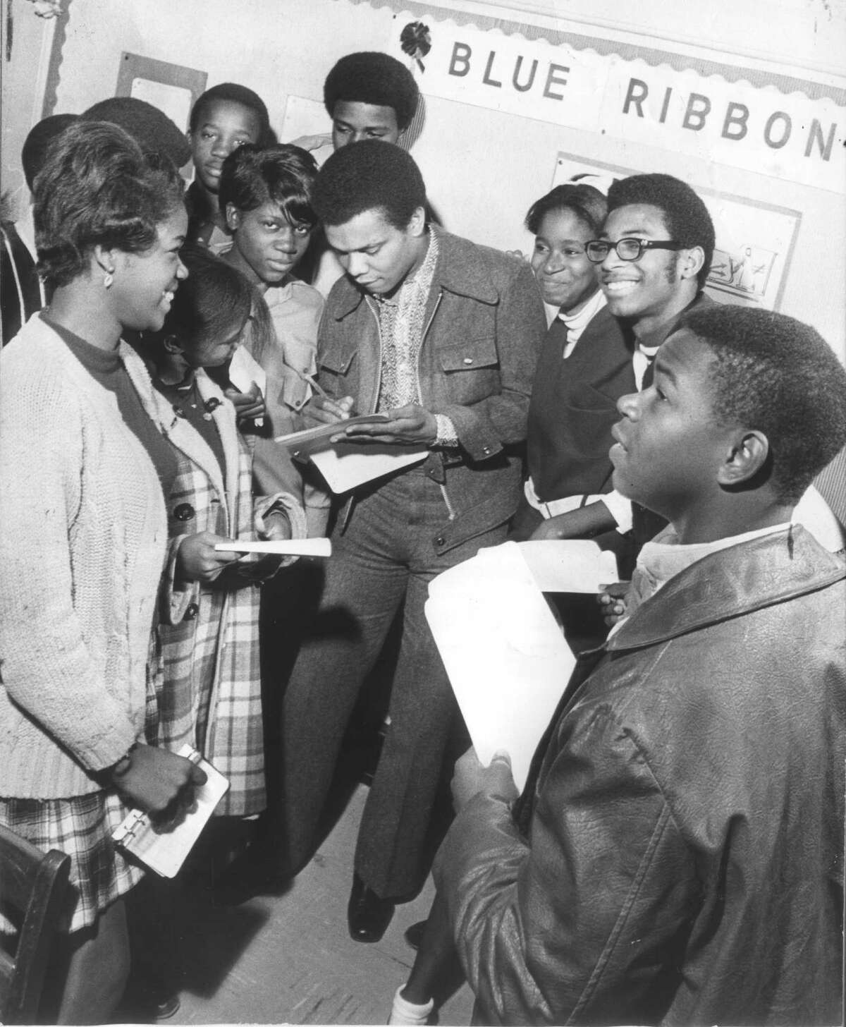 Johnny Nash signs autographs at Houston's Ryan Junior High in 1969.