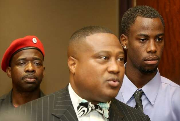 Chad Holley listens as Quanell X speaks to the media after Chad signed his court rescheduled papers at the 178th court in Houston, Texas, on Friday, June 15. (Thomas B. Shea / For the Chronicle )