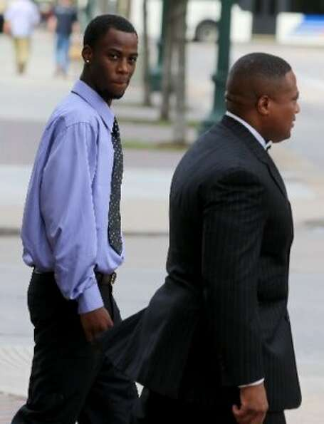 Chad Holley walks with Quanell X after leaving the 178th court in Houston, Texas, on Friday, June 15