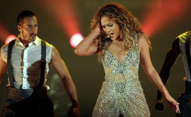 "Singer Jennifer Lopez, right, performs during a concert, part of her ""Dance Again Tour"" in Panama City, Thursday, June 14, 2012. Photo: Arnulfo Franco, AP / AP"