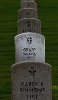 The grave of Grady Green, WWII veteran, buried at  Houston National Cemetery, Tuesday, May 15, 2012, in Houston. investigative story about veterans all across Texas who were ripped off by the people who were supposed to take care of their money. This veteran had his money stolen by a Houston woman who was supposed to be his caregiver - she got $5,000 to buy him a grave and pay for his care and instead blew it on her own bills, traffic tickets and plumbing repairs. He died before the VA got around to investigating the case or prosecuting the woman who stole from him. ( Karen Warren / Houston Chronicle ) Photo: Karen Warren, Houston Chronicle / © 2012  Houston Chronicle