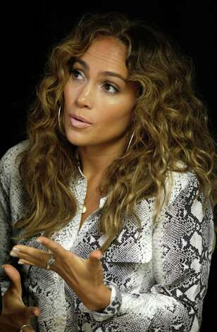 Jennifer Lopez speaks during a ceremony at which she donated medical equipment to The Children's Hospital, via the Lopez Family Foundation, in Panama City, Tuesday, June 12, 2012. Lopez will perform on June 14 as part of her Dance Again world tour that kicks off in Panama City. Photo: Arnulfo Franco, AP / AP