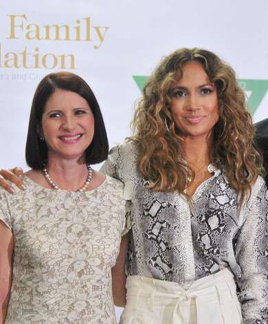 Singer and actress Jennifer Lopez (R) is seen alongside Panamanian First Lady Marta Linares de Martinelli at the Hospital del Nino (Children´s Hospital) in Panama City on June 12, 2012. Lopez visited the hospital and donated telemedicine equipment that will allow pediatricians to share diagnostics and treatments with hospitals abroad. AFP PHOTO/STRSTR/AFP/GettyImages Photo: STR, AFP/Getty Images / AFP