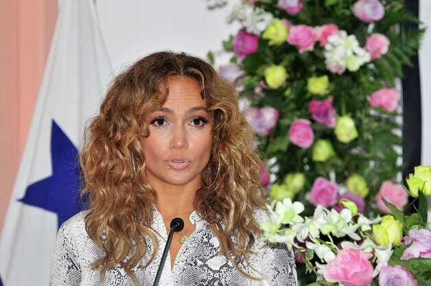 Singer and actress Jennifer Lopez is seen during a press conference at the Hospital del Nino (Children´s Hospital) in Panama City on June 12, 2012. Lopez visited the hospital and donated telemedicine equipment that will allow pediatricians to share diagnostics and treatments with hospitals abroad. AFP PHOTO/STR  STR/AFP/GettyImages Photo: STR, AFP/Getty Images / AFP