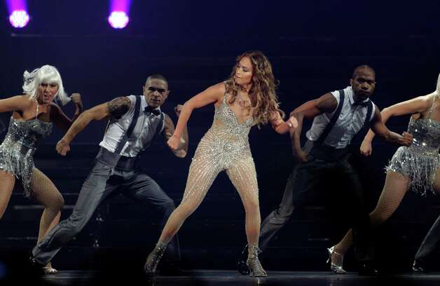 "Singer Jennifer Lopez, center, performs during a concert, part of her ""Dance Again Tour"" in Panama City, Thursday, June 14, 2012. Photo: Arnulfo Franco, AP / AP"