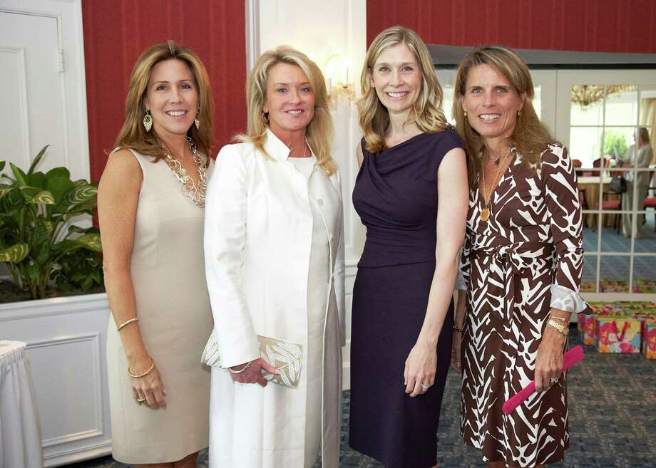 Marie Tillman, second from right, talked about the death of her husband, former NFL star Pat Tillman who was killed by friendly fire as an Army Ranger during his second tour of duty in Afghanistan, at the  2012 Center for HOPE Luncheon, which was held recently. Pictured with her here are, from left, and event co-chairs KK Lowther of Greenwich, Terri Walker of Rowayton and Heather Pech of Greenwich. Photo: Contributed Photo / Greenwich Citizen