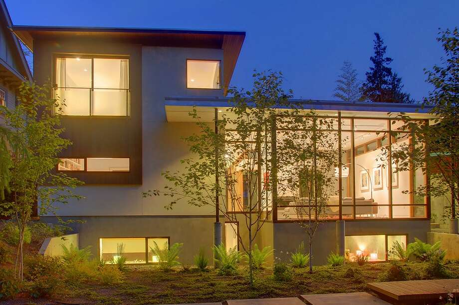 This week's spotlight focuses on a sleek contemporary home in the Arboretum area, at 2609 E. Interlaken Boulevard. The 4,450-square-foot house, built in 2009, has four bedrooms and 4.25 bathrooms, including a guesthouse above the detached garage, walls of walnut-wrapped windows, concrete and wood floors and a patio. It's listed for $1.85 million. Photo: Vista Estate Imaging/Courtesy Heidi And Rick Ward/Coldwell Banker Bain