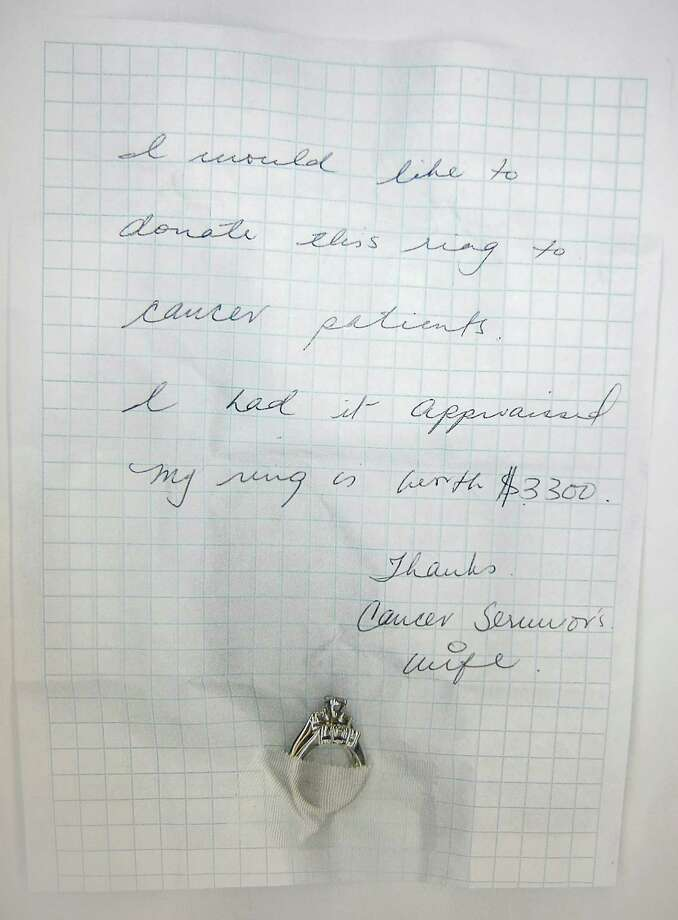 "A mysterious lady appears to have left her special jewelry in the chapel of St. VincentâÄôs Medical Center some time on Wednesday June 13, 2012, next to a statue of the Virgin Mary. The wedding and engagement rings were affixed to a note raedingâÄú""iwould like to donate this ring to cancer patients. I had it appraised. My ring is worth $3,300.""The note was signed simply, âÄúCancer SurvivorâÄôs Wifee."" Photo: Contributed Photo / Connecticut Post Contributed"