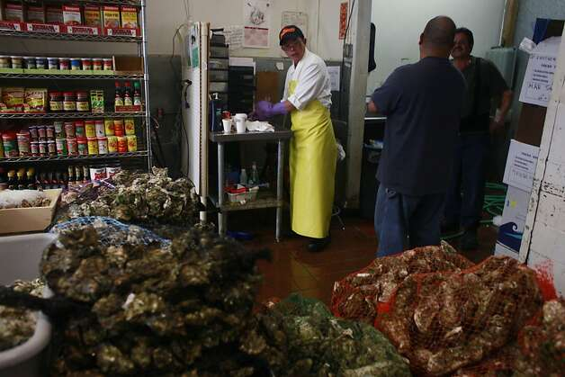 Andy Lai checks in a new shipment of 500 dozen oysters at Sun Fat Seafood Co. in San Francisco, Calif. Photo: Mike Kepka, The Chronicle
