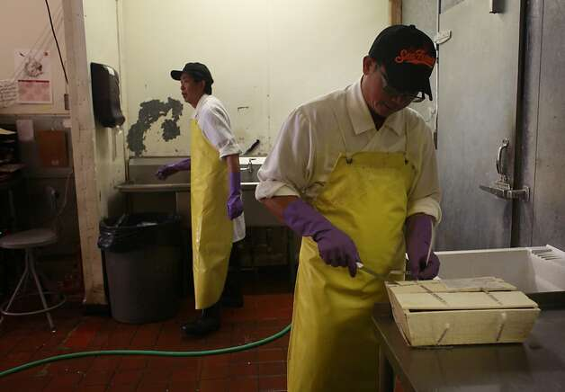 Andy Lai opens a new case of beaus soleil oysters at Sun Fat Seafood Co. in San Francisco, Calif. Photo: Mike Kepka, The Chronicle