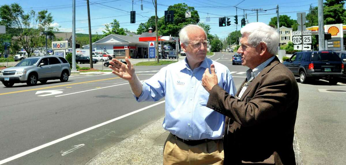Christopher Shays, a Republican candidate for U.S. Senate, left, and Brookfield Selectman George Walker, discuss the revitilization of Four Corners in Brookfield Friday, June 15, 2012.