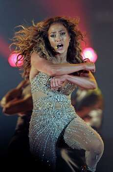 "Singer Jennifer Lopez performs in her ""Dance Again"" world tour that kicked off in Panama City, Thursday, June 14, 2012. (AP Photo/Arnulfo Franco) Photo: Arnulfo Franco, Associated Press / AP"
