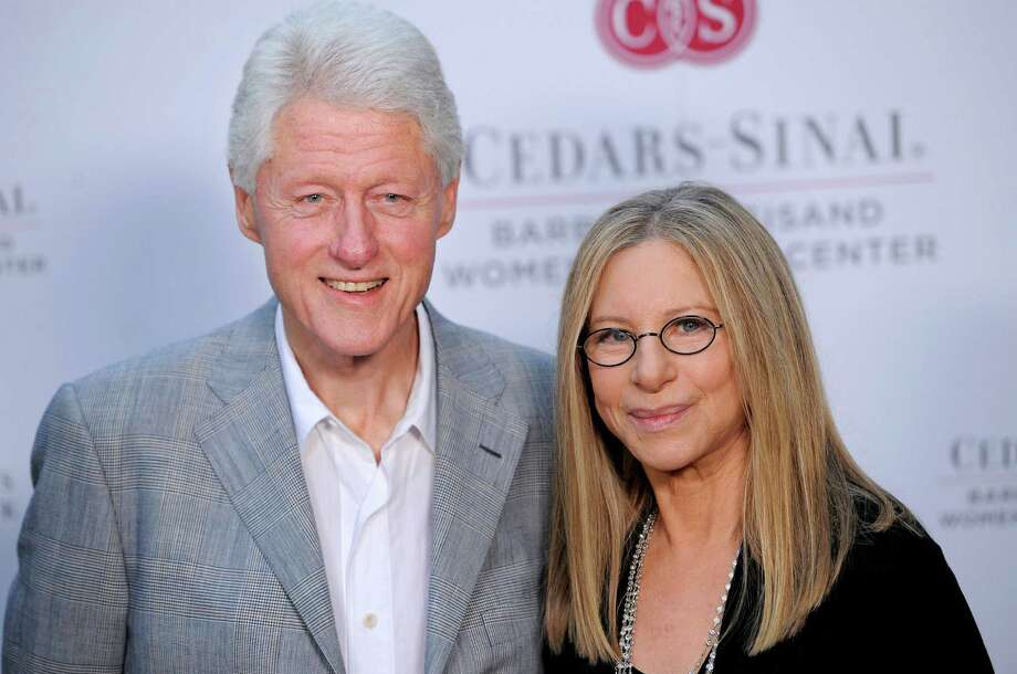 Former President Bill Clinton poses with Barbra Streisand at the dedication of the Barbra Streisand Women's Heart Center in the Cedars-Sinai Heart Institute, on Thursday June 14, 2012, at Streisand's home in Malibu, Calif. (Photo by Chris Pizzello/Invision/AP) Photo: Chris Pizzello