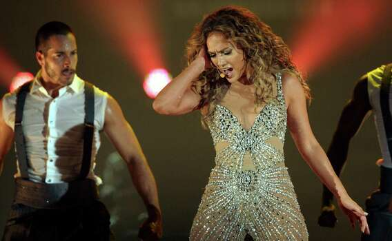 "Singer Jennifer Lopez, right, performs during a concert, part of her ""Dance Again Tour"" in Panama City, Thursday, June 14, 2012. (AP Photo/Arnulfo Franco) Photo: Arnulfo Franco, Associated Press / AP"
