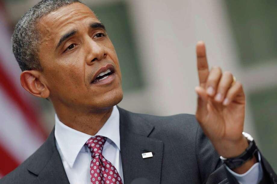 Barack Obama responde una pregunta de Neil Munro, del Daily Caller, quien interrumpió al presidente mientras hablaba sobre el DREAM Act, el viernes 15 de junio en Washington, DC. Photo: Alex Wong / 2012 Getty Images
