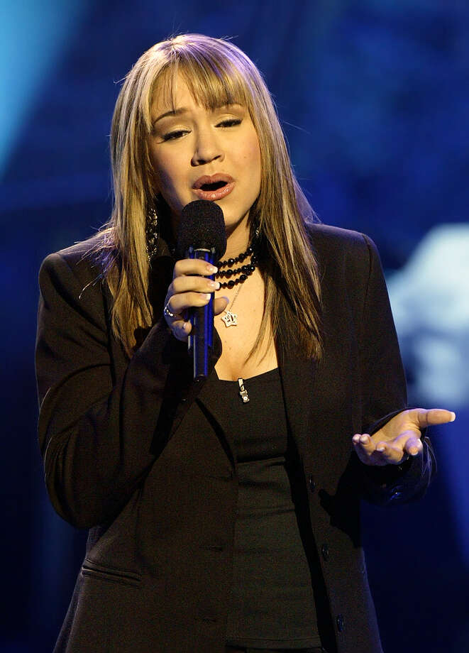 "** FILE ** Diana DeGarmo performs ""The Impossible Dream"" during the ""American Idol"" live finale, in a  Wednesday, May 26, 2004 photo, in Los Angeles. Another ""American Idol"" contestant is heading for Broadway. Following in the footsteps of Frenchie Davis, who appears in the rock musical ""Rent,"" Diana DeGarmo will join the cast of ""Hairspray"" on Feb. 7. The 18-year-old DeGarmo, one of the FOX television series' most popular runners-up, will portray the heroine's best friend, Penny Pingleton, in the musical, which opened on Broadway in August 2002.  (AP Photo/Kevork Djansezian, file) Photo: KEVORK DJANSEZIAN"