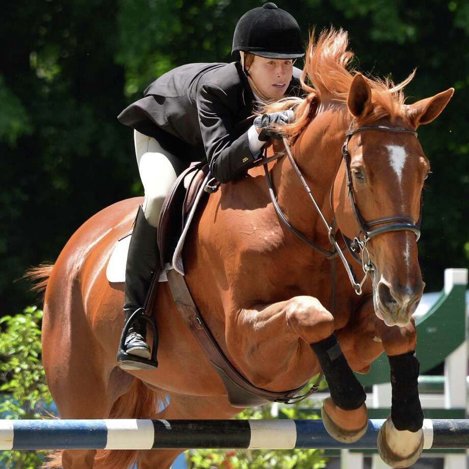 """Ali Wagstaff of Wrentham, Mass., aboard """"Wynonna,"""" competes in thejunior  amateur/owner low jumper classat the Skidmore College Saratoga Classic Horse Show in Saratoga Springs on Friday, June 15, 2012.   (John Carl D'Annibale / Times Union) Photo: John Carl D'Annibale / 00018103A"""