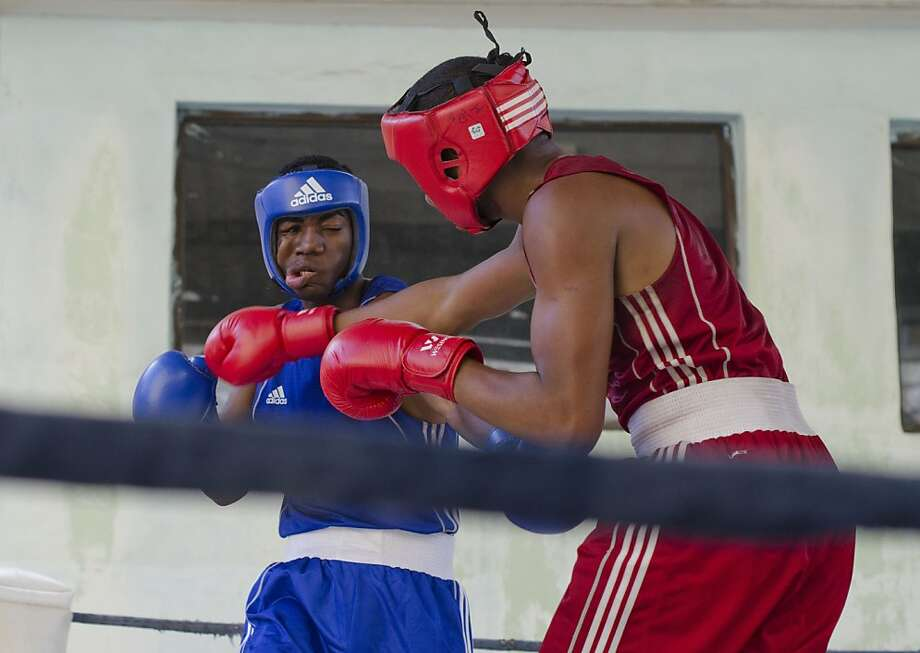 One Cuban boxer connects with another as they compete in the National Championships. Photo: James Tensuan