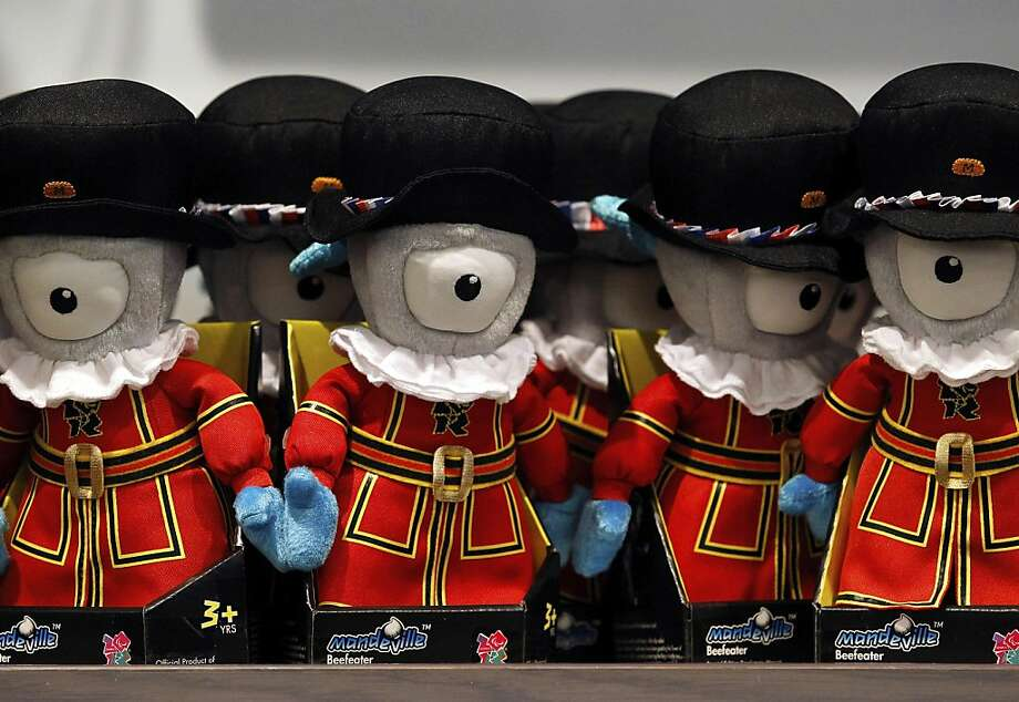 "Official London 2012 Olympic ""Mandeville"" mascot souvenirs, dressed as Beefeaters, sit on display inside a John Lewis Plc store at the Westfield Stratford City mall, operated by Westfield Group, in London, U.K., on Tuesday, June 12, 2012. London Olympics organizers raised more than 700 million pounds ($1.1 billion) in domestic sponsorship, including from shopping mall-owner Westfield Group, British Airways and BT Group Plc. Photo: Paul Thomas, Bloomberg"