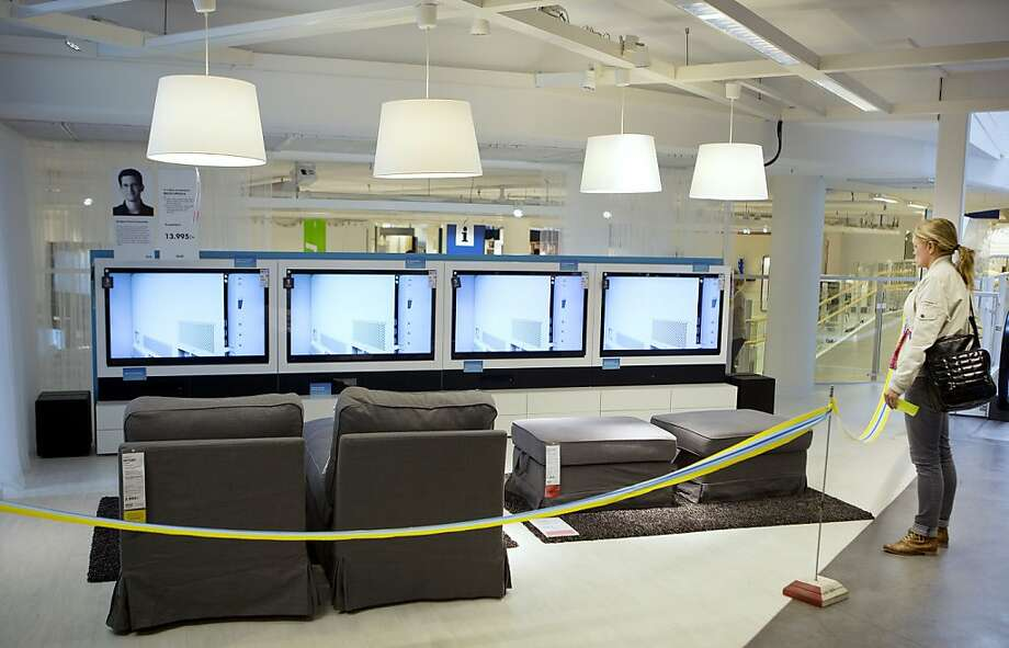 "A customer looks at a display of ""Uppleva"" television sets, manufactured by Ikea AB, as they sit on display amongst other Ikea products during its launch at one of the company's stores in Stockholm, Sweden, on Wednesday, June 13, 2012. IKEA, the retailer known for its self-assembled furniture, has started selling smart televisions integrated into cabinets and stands with speakers and blu-ray players in a bid to tap into the market for home theater systems. Photographer: Casper Hedberg/Bloomberg Photo: Casper Hedberg, Bloomberg"