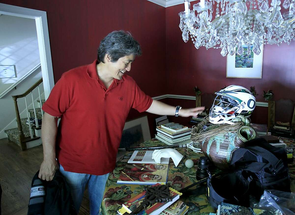 Guy Kawasaki laughs as he cleans off a table in his Atherton home. Tech evangelist Guy Kawasaki calls himself a curator of information as he runs his web sites, makes speeches, writes books, and even plays hockey near his home in Atherton, Calif.
