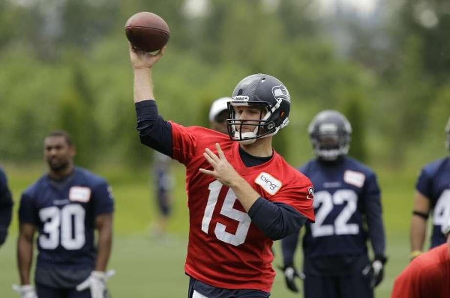 Seattle Seahawks quarterback Matt Flynn throws a pass during practice Thursday, June 14, 2012, in Renton. (Ted S. Warren / Associated Press)