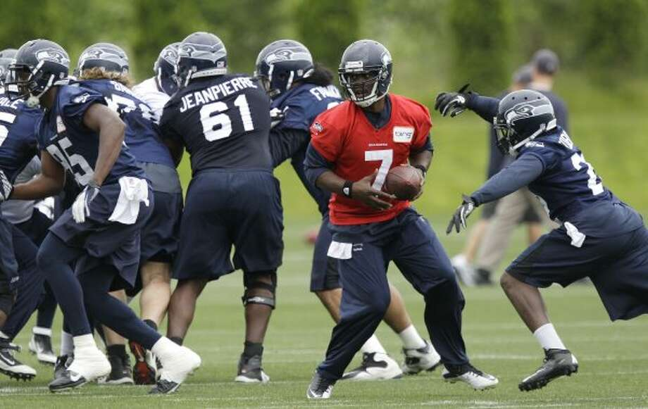 Seattle Seahawks quarterback Tavaris Jackson (7) drops back with the football during practice Thursday, June 14, 2012, in Renton. (Ted S. Warren / Associated Press)