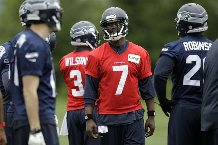 Seattle Seahawks quarterback Tavaris Jackson (7) reacts to a play during practice Thursday, June 14, 2012, in Renton. (Ted S. Warren / Associated Press)