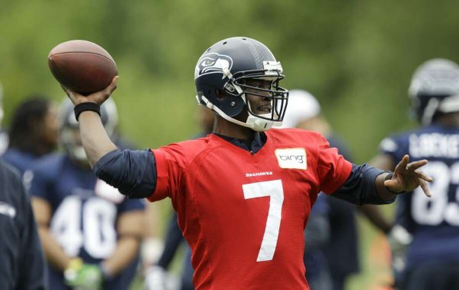 Seattle Seahawks quarterback Tavaris Jackson throws a pass during practice Thursday, June 14, 2012, in Renton. (Ted S. Warren / Associated Press)