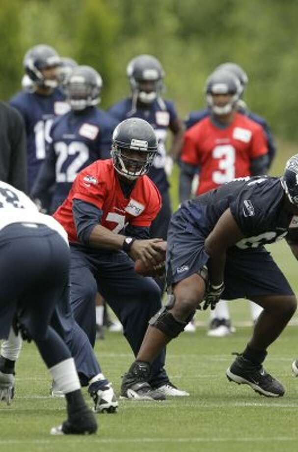 Seattle Seahawks quarterback Tavaris Jackson takes a snap, Thursday, June 14, 2012, during practice Thursday, June 14, 2012, in Renton. (Ted S. Warren / Associated Press)