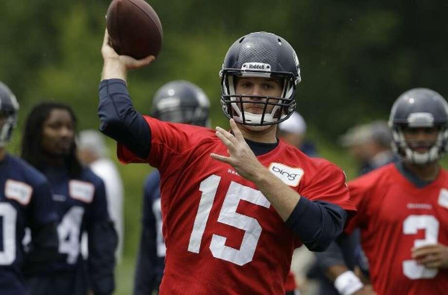 Seattle Seahawks quarterback Matt Flynn passes, Thursday, June 14, 2012,during practice Thursday, June 14, 2012, in Renton. (Ted S. Warren / Associated Press)