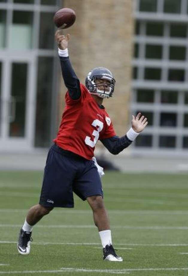 Seattle Seahawks quarterback Russell Wilson passes Thursday, June 14, 2012, during practice Thursday, June 14, 2012, in Renton. (Ted S. Warren / Associated Press)