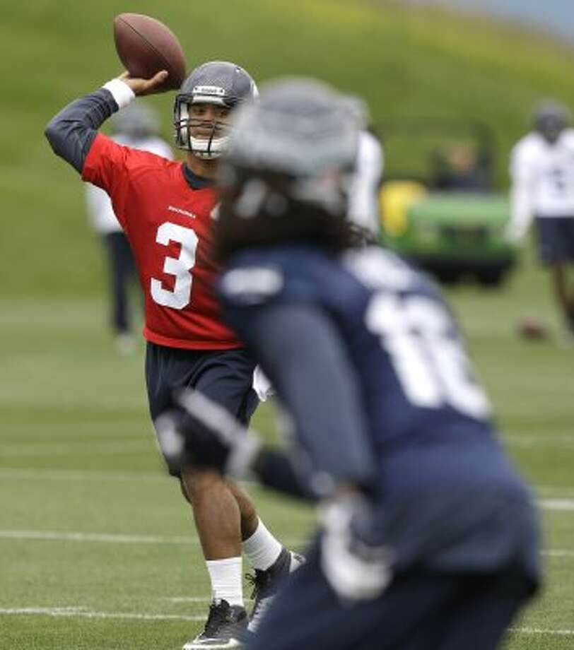 Seattle Seahawks quarterback Russell Wilson passes Thursday, June 14, 2012, during practice Thursday, June 14, 2012, in Renton. (Ted S. Warren / Associated Press)