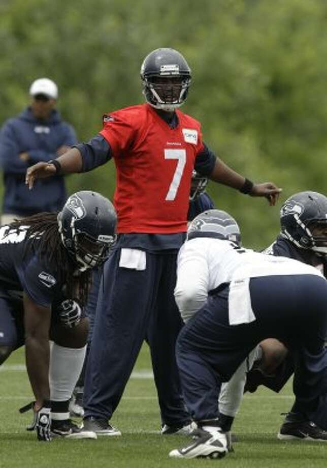 Seattle Seahawks quarterback Tavaris Jackson calls to his team, Thursday, June 14, 2012, during practice Thursday, June 14, 2012, in Renton. (Ted S. Warren / Associated Press)