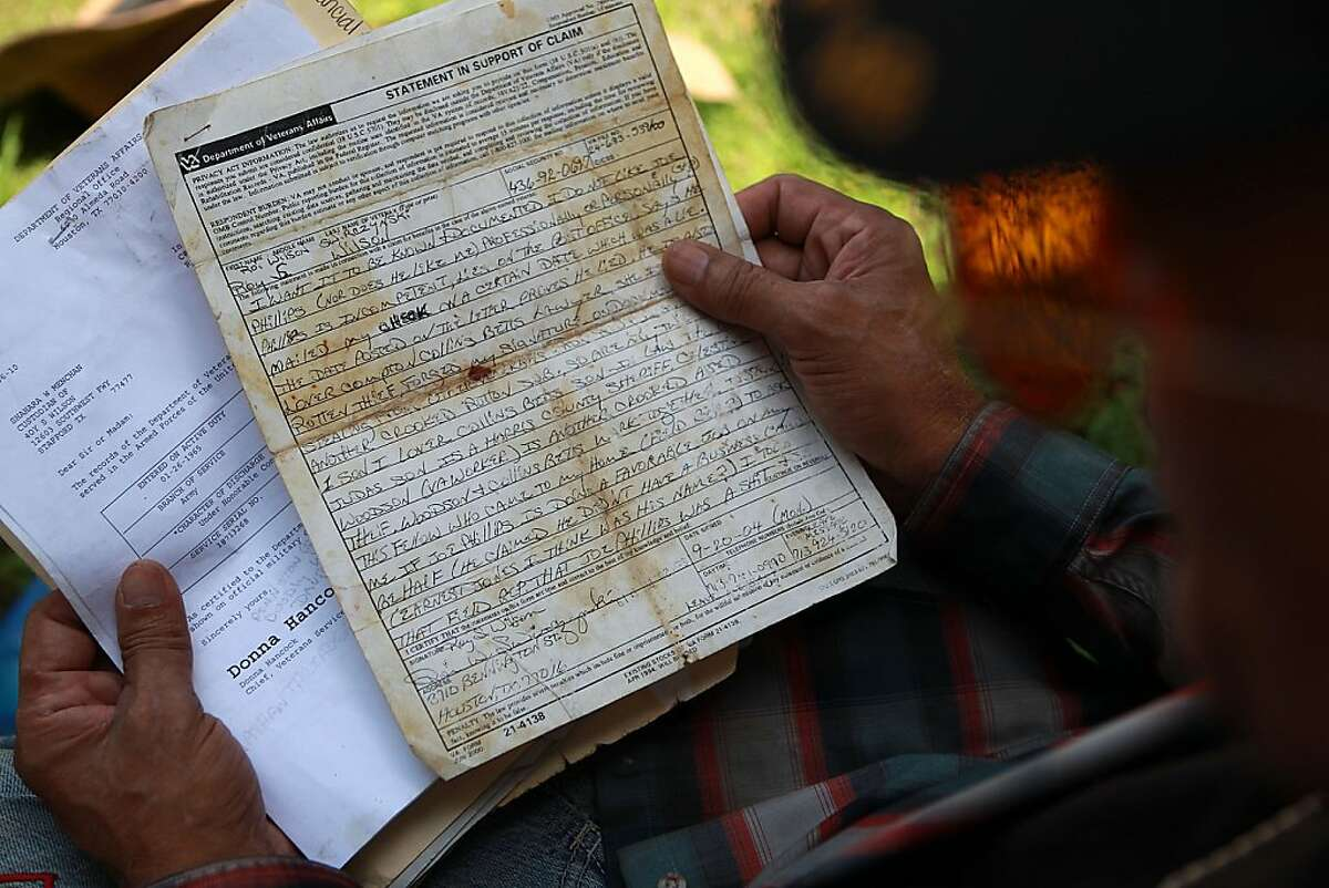 PLEASE REPLACE EARLIER PHOTOS WITH THESE. THE CAPTIONS HAVE BEEN MODIFIED. Roy Wilson Swirczynski, a disabled veteran, holds one of his written complaints about the actions of attorney Joe Phillips. (Johnny Hanson/ Houston Chronicle)