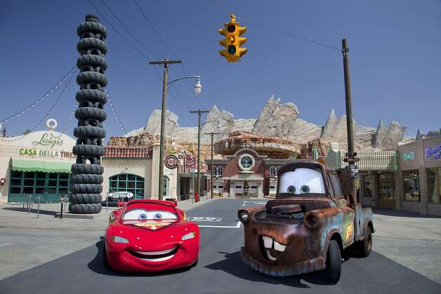 "This May 2012 photo released by Disneyland shows characters Lightning McQueen, left, and Mater at the new 12-acre Cars Land, a replica of Radiator Springs, the town in the popular ""Cars,"" film franchise at Disney California Adventure park at Disneyland Resort in Anaheim, Calif.  The park's five-year, $1 billion-plus revamp has debuted in spurts since 2008. Most of its new features rely on characters that come from Disney's $7.4 billion acquisition of Pixar Animation Studios, the San Francisco-area studio behind ""Cars,"" `'Toy Story,"" `'Monsters Inc."" and ""A Bug's Life.""  (AP Photo/Disneyland Resort, Paul Hiffmeyer) Photo: Paul Hiffmeyer, Associated Press"