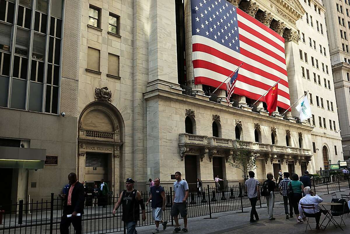 NEW YORK, NY - JUNE 15: People walk by the New York Stock Exchange on June 15, 2012 in New York City. Bankers, businesses and investors around the globe are waiting to see the outcome of Sundays election in Greece which could see the leftist party Syriza come to power and hasten a Greek exit from the euro. That outcome could spread financial turmoil throughout global markets. (Photo by Spencer Platt/Getty Images)