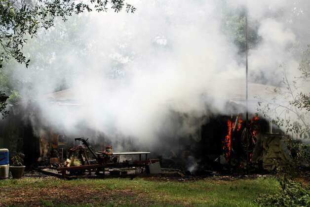 Fire destroyed a home on Williamson Road, north of Silsbee, Friday afternoon, June 15. The fire was reported as a kitchen fire, but firefighters arrived to find the home fully engulfed. Photo: David Lisenby, HCN_Fire 061520