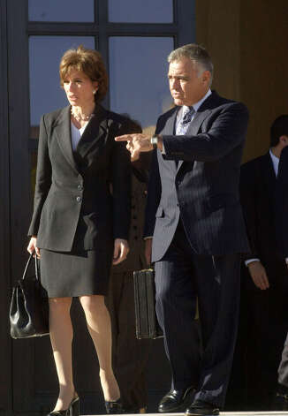 FILE — Westchester County District Attorney Jeanine Pirro, left, leaves the Federal Courthouse in White Plains, N.Y. with her husband Albert Pirro, after Mr. Pirro was sentenced to 29 months for tax evasion and conspiracy in this Nov. 1, 2000, file photo. The Pirros have put their New York and Florida homes on the market, fueling speculation that their 32-year marriage may be coming to an end. Jeanine Pirro's political career was damaged during her 2006 bid to become New York's attorney general when federal authorities announced they were investigating her attempt to eavesdrop on her husband because she suspected him of cheating on her again, with a woman who was the couple's friend. (AP Photo/Stephen Chernin, File) Photo: Stephen Chernin, ASSOCIATED PRESS / Associated Press
