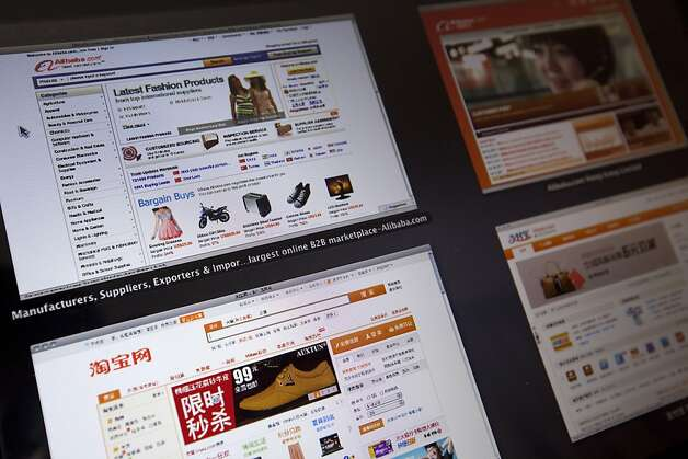 Alibaba Group Holding Ltd.'s website, top left, in addition to the company's Alibaba.com, top right, clockwise, Alipay.com and Taobao.com websites are arranged on a computer in Shenyang, Liaoning Province, China, on Wednesday, May 23, 2012. Alibaba, who agreed to repurchase about half of Yahoo! Inc.'s stake in itself, may borrow as much as $2 billion from China Development Bank Corp. and another $2 billion from a syndicate of international lenders, according to two people familiar with the matter. Photographer: Nelson Ching/Bloomberg Photo: Nelson Ching, Bloomberg